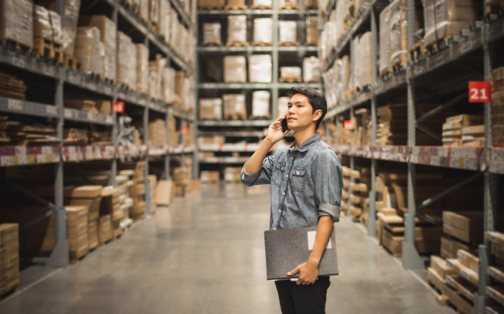 worker standing in a warehouse aisle