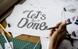 """""""let's get it done"""" written on a piece of paper"""